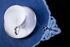 Cup on doily Stock Photography