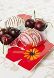 Cup of donut and Cherry in beautiful flower plate Stock Photos
