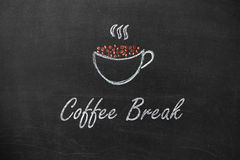 Cup drawn with chalk on black board and text Coffee Break Stock Photos