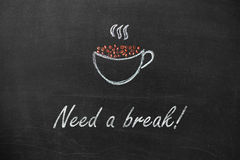 Cup drawn with chalk on black board and text Need a break Royalty Free Stock Photography