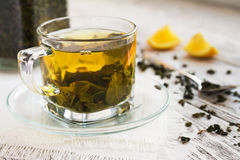 Cup of dreen tea with lemon on a table Stock Images