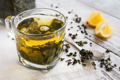 Cup of dreen tea with lemon on a table Royalty Free Stock Image