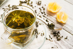 Cup of dreen tea with lemon on a table Royalty Free Stock Photography
