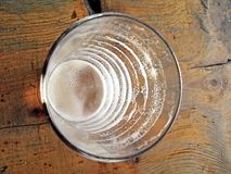 Cup and drink beer signs of dwindling. Royalty Free Stock Photos