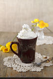Cup of drink and yellow flowers Royalty Free Stock Photography