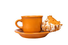 Cup and eclair. Isolated on the white background Royalty Free Stock Photography