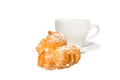 Cup and eclair. Isolated on the white background with clipping path Stock Photo