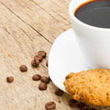 Cup of ecpresso with cookies on old wooden table Royalty Free Stock Image