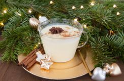 Cup of egg nog. With cinnamon and nutmeg stock photography