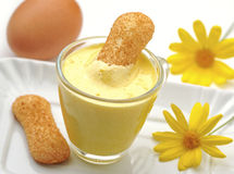 Cup of eggnog with cookie Stock Images
