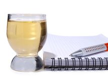 Cup and empty notebook Stock Photo