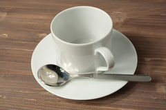 Cup and empty white plate Royalty Free Stock Image