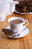 Cup of English Tea with Cake for Tea Break in Afternoon. With silver spoon and bowl of sugar cubes Stock Photography
