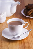 Cup of English Tea with Cake for Tea Break in Afternoon. With silver spoon and bowl of sugar cubes Stock Photo