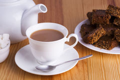 Cup of English Tea with Cake for Tea Break in Afternoon. With silver spoon and bowl of sugar cubes Royalty Free Stock Photos
