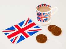 A cup of English tea and chocolate biscuits with a flag Stock Images