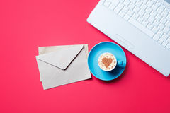 Cup. envelopes and laptop Stock Photography