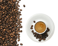 Cup Of Espresso. Espresso cup and coffee beans on white background Stock Image