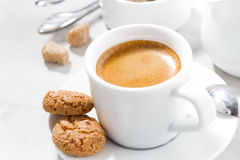 Cup of espresso and almond cookies on a white table, closeup Royalty Free Stock Image