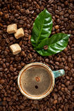 Cup of espresso with a background of coffee beans Stock Images