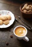 Cup of espresso with biscotti Stock Photography