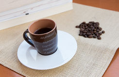 Cup  espresso black coffee and roasted beans Royalty Free Stock Images