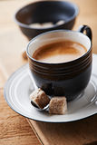 Cup of espresso with brown sugar cubs Stock Photo