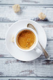 Cup of espresso with brown sugar Royalty Free Stock Photos