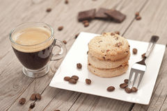Cup of espresso and chocolate chip cookies. Royalty Free Stock Images