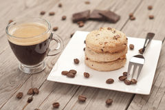 Cup of espresso and chocolate chip cookies. Stock Photo