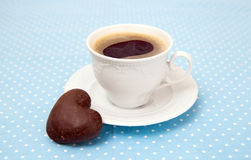 Cup of espresso and chocolate cookie Stock Photos