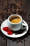 Cup of espresso and chocolate sweets in the form of a heart Royalty Free Stock Photos