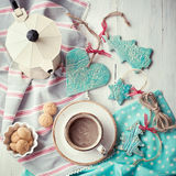 Cup of espresso and Christmas decorations on a wooden table Royalty Free Stock Photo