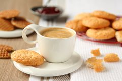 Cup of espresso with coconut cookies on a plate Stock Photo