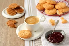 Cup of espresso with coconut cookies on a plate Royalty Free Stock Photo