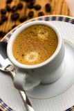 Cup of Espresso with Coffee Beans Stock Photos