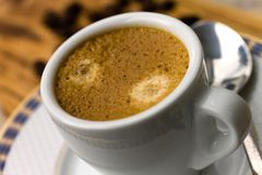 Cup of Espresso with Coffee Beans Royalty Free Stock Image