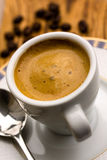 Cup of Espresso with Coffee Beans Stock Photo