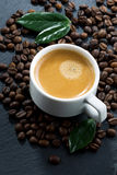 Cup of espresso on coffee beans background, top view Royalty Free Stock Image