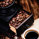 Cup of espresso with coffee beans and Coffee mill with roasted c stock photo