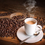 Cup of espresso coffee and beans Royalty Free Stock Photos