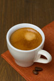 Cup of espresso and coffee beans Stock Image