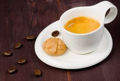 Cup of espresso coffee and biscuit near coffee beans Royalty Free Stock Image
