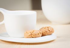 Cup of espresso coffee and biscuit near sugar bowl Royalty Free Stock Photos