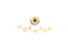 Cup of espresso coffee for breakfast with cookies in shape of morning word Stock Photo