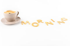Cup of espresso coffee for breakfast with cookies in shape of morning word Royalty Free Stock Image
