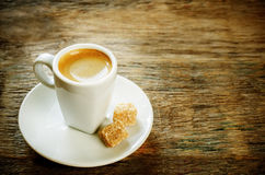Cup espresso coffee with cane sugar Royalty Free Stock Images