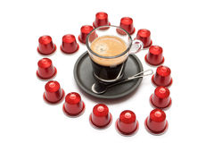 A cup of espresso coffee capsules Stock Photo