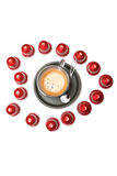 A cup of espresso coffee capsules Stock Image