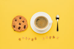 Cup of espresso coffee, chocolate cookie, spoon and coffee break lettering. Top view of cup of espresso coffee, chocolate cookie, spoon and coffee break Royalty Free Stock Image